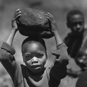 Affrican_Child_Labor_Carrying_a_Big_Rock